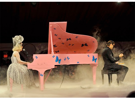 lady gaga played a nipple-pink, butterfly tattooed, steinway grand piano