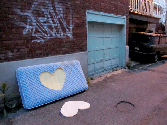 Roadsworth-dead-hearts-Canadian-street-art