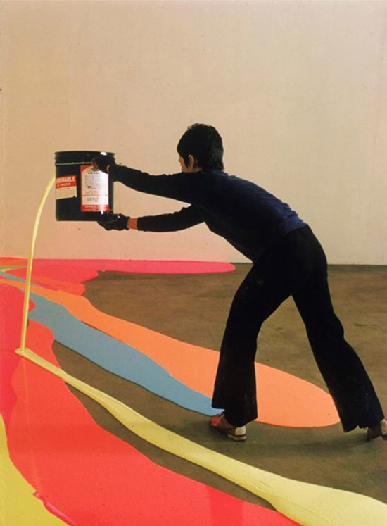 Artist Lynda Benglis painting floor with bright neon paint 01