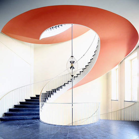 Orange spiral stairwell staircase