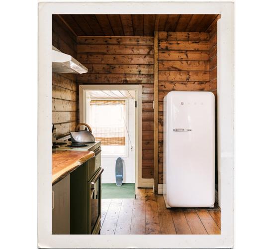 White Smeg refrigerator rustic kitchen