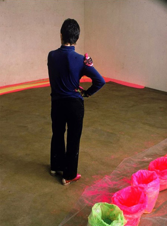 Artist Lynda Benglis painting floor with bright neon paint 05