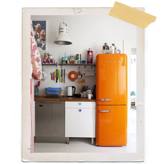 Orange Smeg refrigerator kitchen