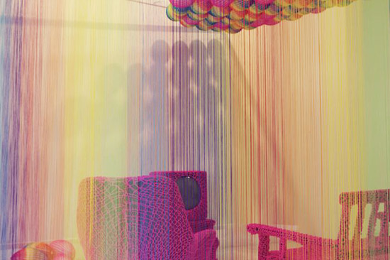 The Rainbow room yarn ceiling and chairs by Pierre Le Riche