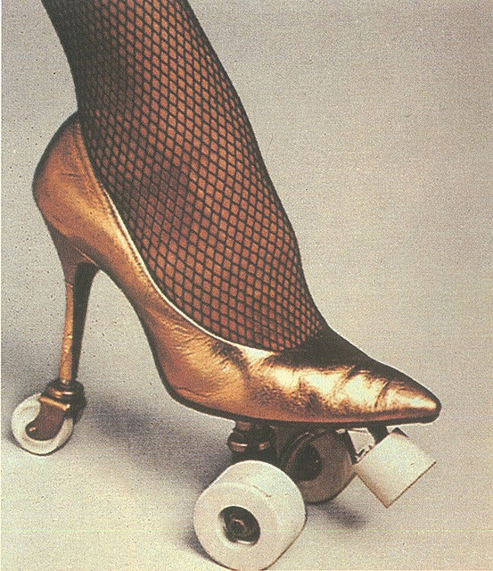 Philip Garner Gold Stiletto Roller Skate