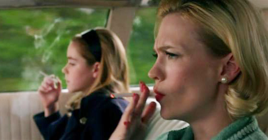 Betty and Sally Draper smoking in car