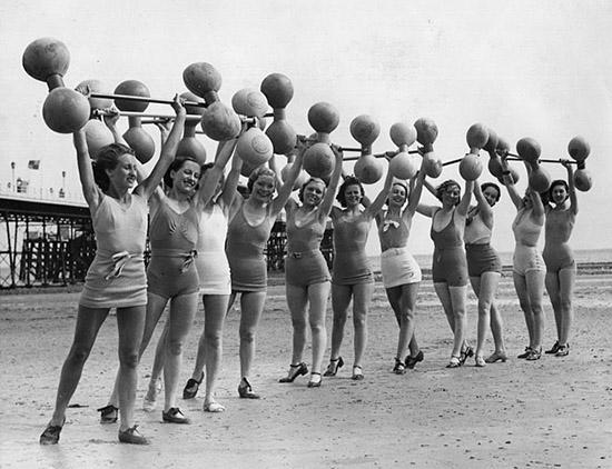 Vintage women exercising lifting dumbells