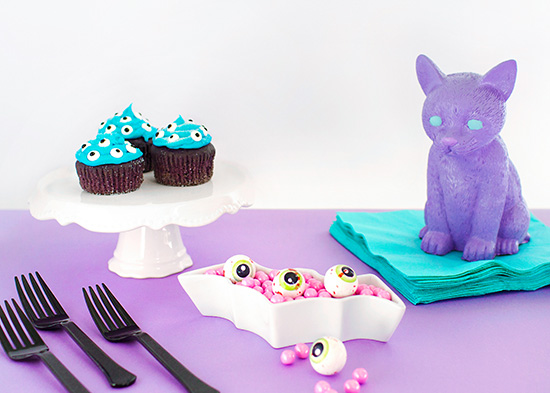 Pastel goth party decor lavender cat and eyeball cupcakes