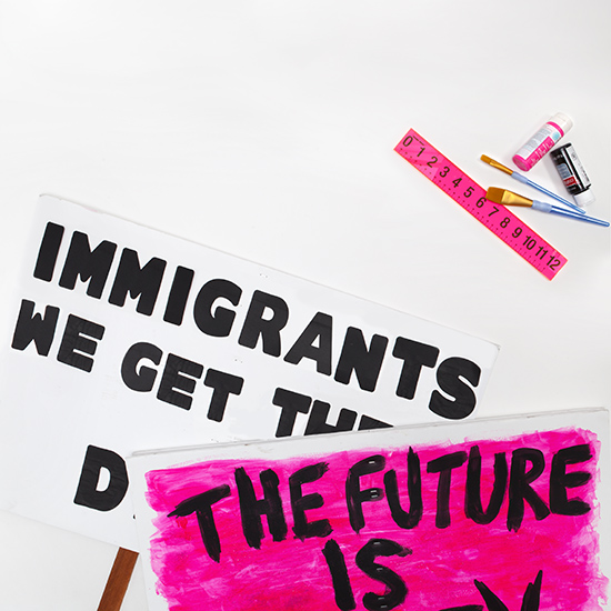 Protest signs immigrants we get the job done