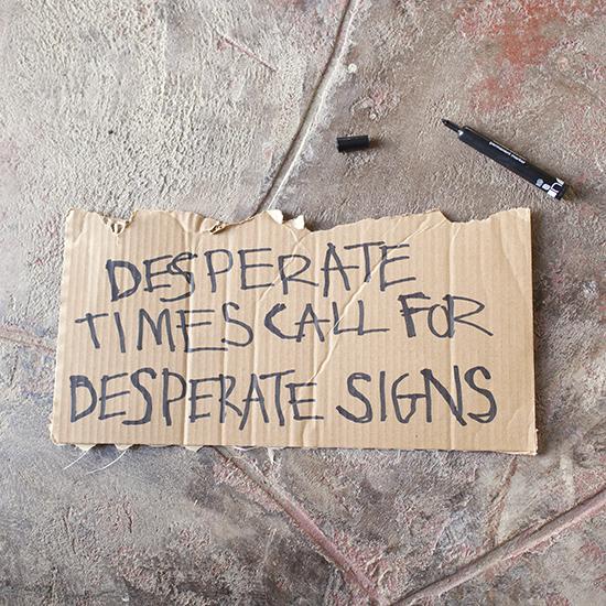 Cardboard sharpie protest sign