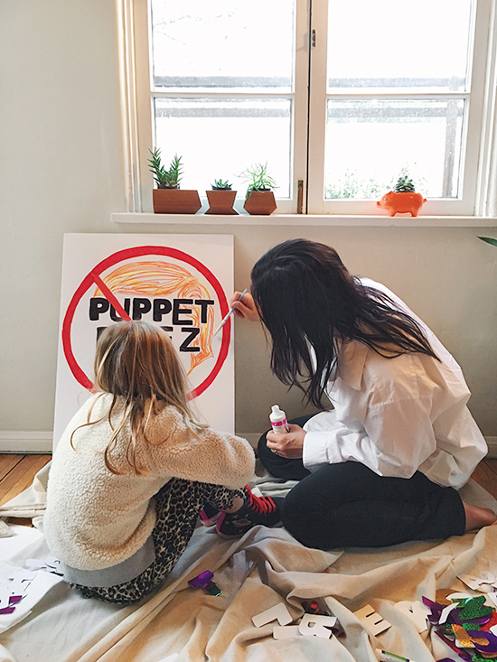 Womens march puppet president sign making